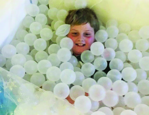 erik in ballpit during therapy